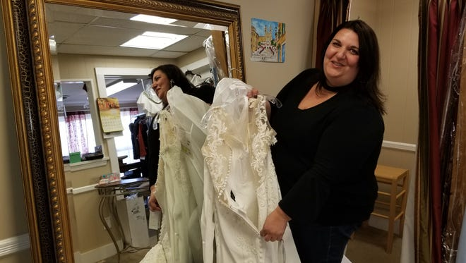 Josephine Lopiccolo discusses the alterations she was making to a wedding dress at Monetti's Tailoring in Bernardsville.  Lopiccolo and her sister, Serafina Stewart, own the shop.