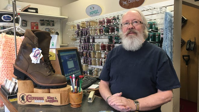 Reid Matteson stands behind the counter of the shoe shop he owns with his wife Jylan, Family Orthopedic and Shoe Repair. The Mattesons are closing the shop April 30.