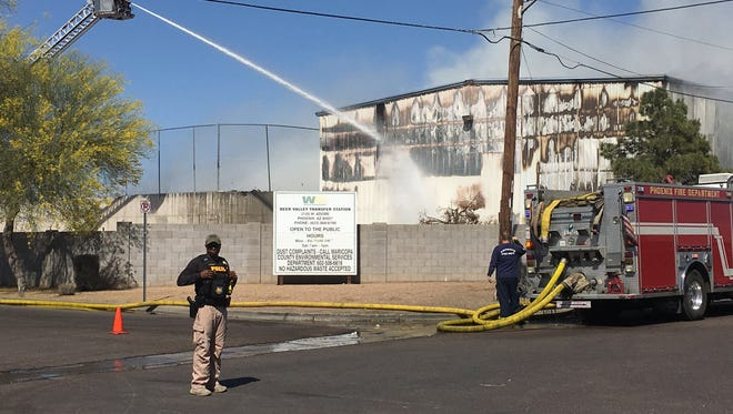 The Phoenix Fire Department work to put out the fire at a Waste Management plant in Phoenix.