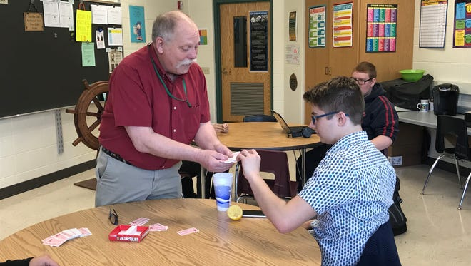 Preble High School GED option 2 program teacher Larry Laraby plays The Ungame with student Jarod Johnson. The non-competitive game helps players develop communications skills.