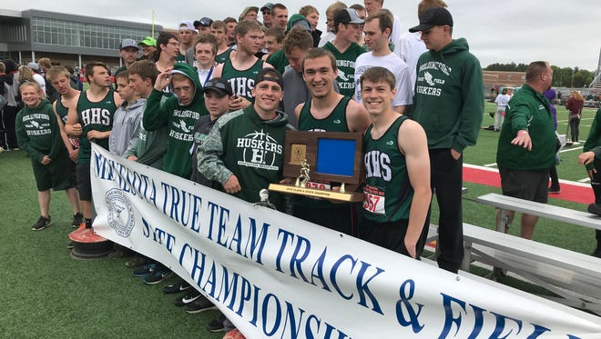 The Holdingford boys track and field team poses with the state championship trophy Saturday at Stillwater Area High School.
