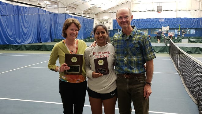 CVU's Stephanie Joseph, center, poses with her coaches, Amy and Ian deGroot. Joseph claimed her second of back-to-back individual tennis state crowns on Saturday.