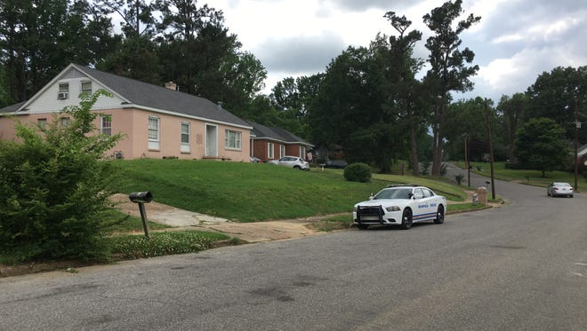 A police car was parked near the site of a double shooting on Wellons Tuesday afternoon.