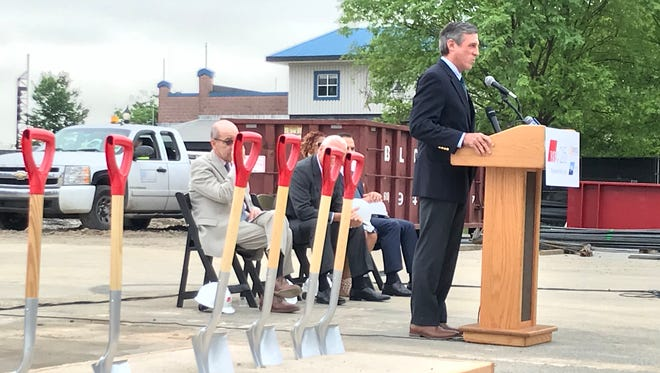 Gov. John Carney speaks at a groundbreaking ceremony Tuesday that kicked off the Buccini/Pollin Group's new Homewood Suites hotel, expected to be completed in about 14 months.