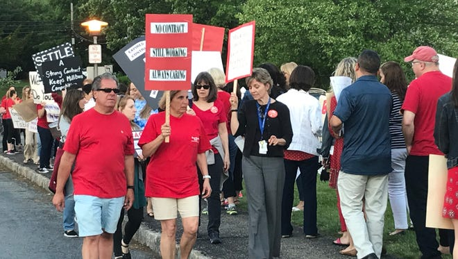 Teachers picket outside of the Millburn Board of Education meeting before the board meeting on May 22. The Millburn Education Association hasn't reached an agreement for its contract, after almost a year of negotiations. Its most recent meeting was May 29.