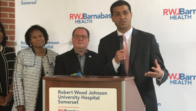 WithNew Jersey Health Commissioner Dr. Shereef Elnahal (right) present Monday, officials at Robert Wood Johnson University Hospital Somerset celebrated the start of PRIDE Month by announcingthe hospital's intention to move PROUD Family Health to a new space with expanded hours along with additional staff and more access to medical specialists.