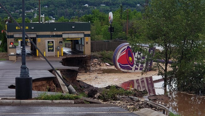 Flooding damaged an area near Razorback Drive in Houghton, Michigan, after a series of storms made their way through the Upper Peninsula, Sunday, June 17, 2018.