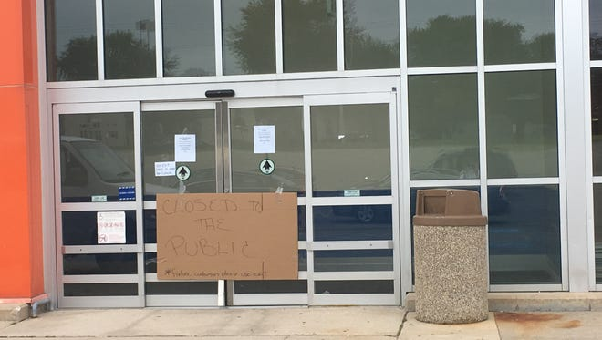 "A cardboard sign on the door of Toys ""R"" Us on Tuesday notifies the public the store is permanently closed."