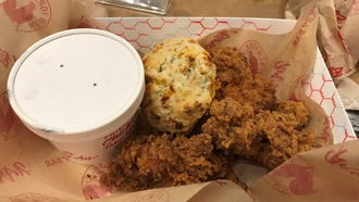 The signature dish is Chef Art's Mix Box, a two-piece serving of light and dark meat fried chicken with a biscuit and choice of side.
