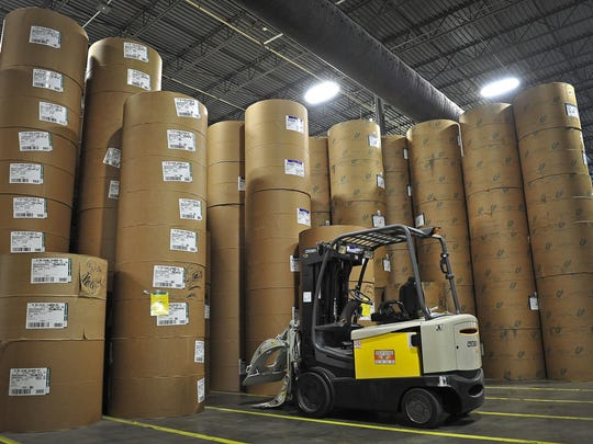 Rolls of paper are stacked at Ingram Content Group's Lighting Source facility in La Vergne. Lightning Source, which prints books on demand and allows one-off printing, is expanding its operations in Jackson.