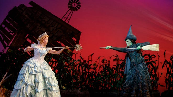 "Ginna Claire Mason, left, as Glinda and Mary Kate Morrissey as Elphaba in the Broadway touring production of ""Wicked."""