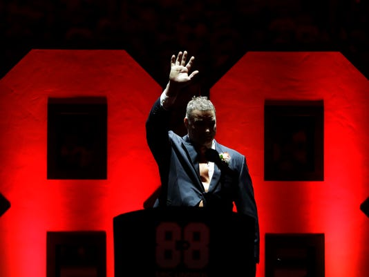 Former Philadelphia Flyers player Eric Lindros waves to the crowd during a jersey retirement ceremony before an NHL hockey game between the Flyers and the Toronto Maple Leafs, Thursday, Jan. 18, 2018, in Philadelphia. (AP Photo/Matt Slocum)