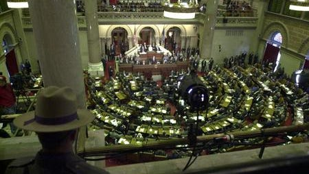 A state trooper keeps watch over the New York State Assembly Chamber as Governor George Pataki delivers his annual State of the State address to the legislature Jan. 7, 2004.  ( Tom Nycz/GNS photo)