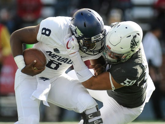Nevada quarterback Kaymen Cureton (8) is sacked by Washington State's Hercules Mata'afa during the teams' 2017 game.