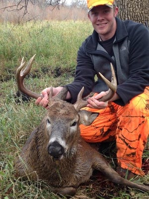 Corey May harvested a mature buck on opening morning of the 2014 firearms opener on some property within the River Bottom Whitetails management cooperative near St Martin.