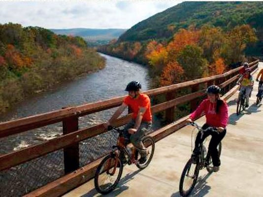 The Pocono Mountains has 260 miles of trails to pedal through. Pictured is the Lehigh Gorge Bridge.