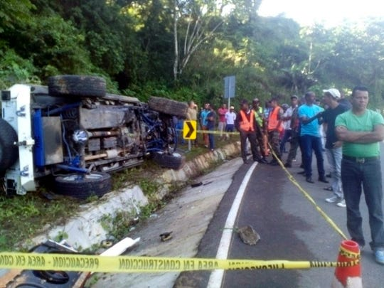 In this photo released by the Dominican Republic Highway Police and Military Commission, locals and authorities stand at the fatal crash site of MLB player Yordano Ventura near Juan Adrian, Dominican Republic on Sunday, Jan. 22, 2017. A federal lawsuit filed by the Caledonian Record of St. Johnsbury accuses the Newport Daily Express of improperly downloading and publishing an Associated Press photograph from this incident.