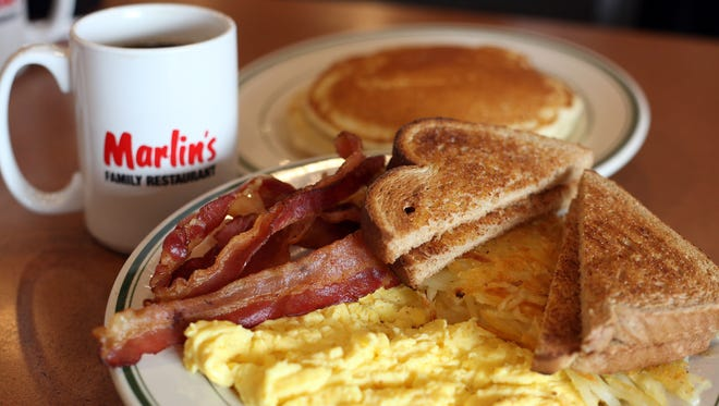 The Belly Buster Breakfast (two eggs with bacon, hash browns and toast), a short stack of pancakes and a cup of coffee at Marlin's Family Restaurant in Tea.