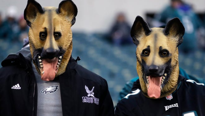 Philadelphia Eagles fans dressed as underdogs watch as players start to warm up before the championship game against the Minnesota Vikings.
