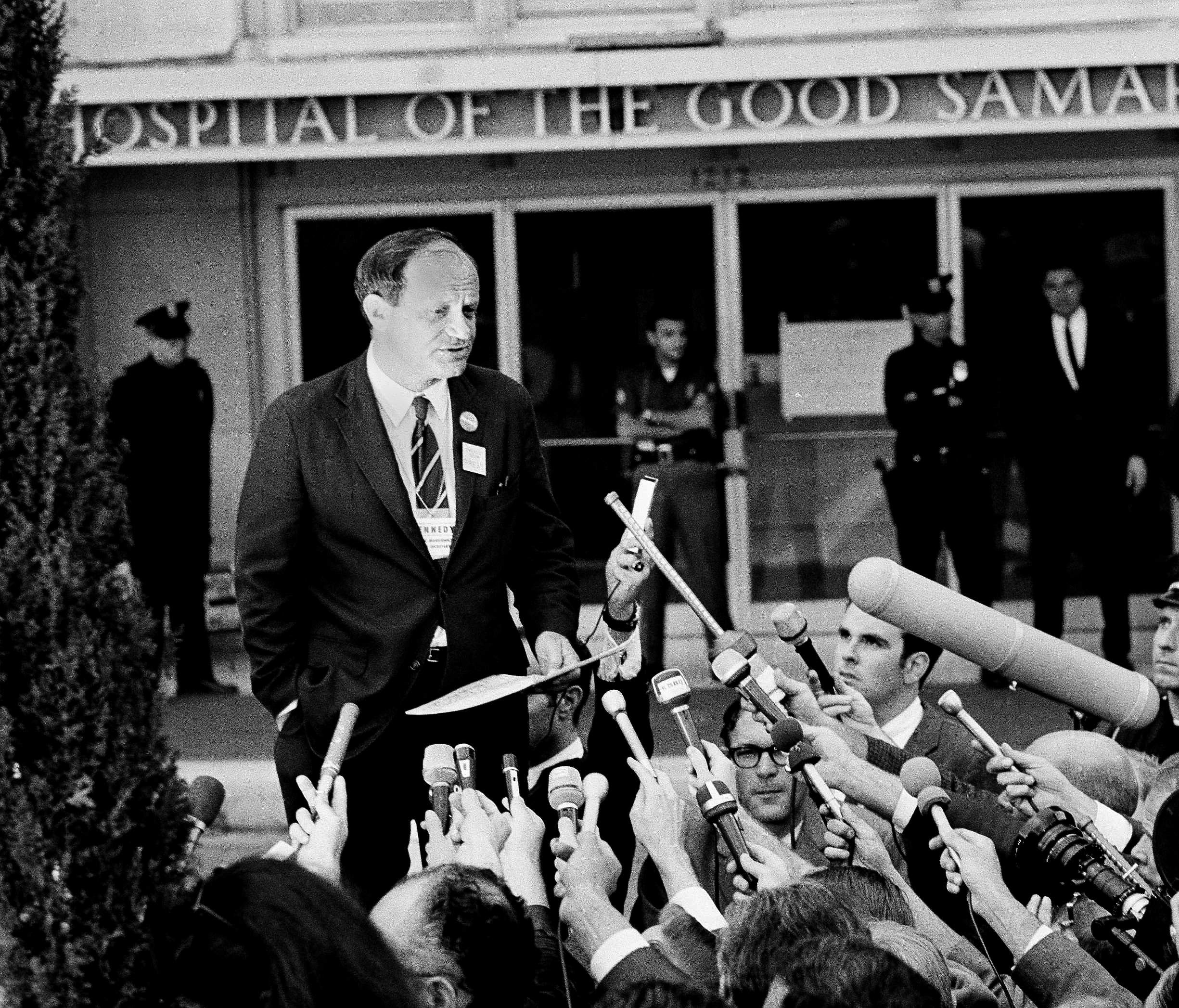 Frank Mankiewicz, press secretary for Robert Kennedy, speaks during news conference outside Good Samaritan hospital in Los Angeles on June 5, 1968. Mankiewicz told journalists that Kennedy emerged from three hours of surgery in