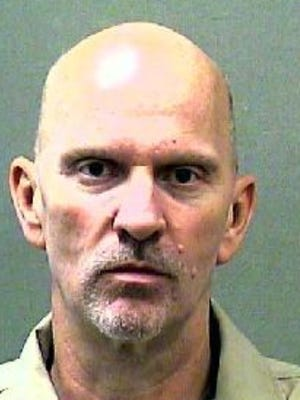 Forrest M. Baker Sr. represented himself in an appeal that overturned his life sentence for multiple robberies.