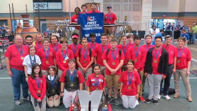 Lafayette Parish robotics team members won a regional competition and are heading to world championships.