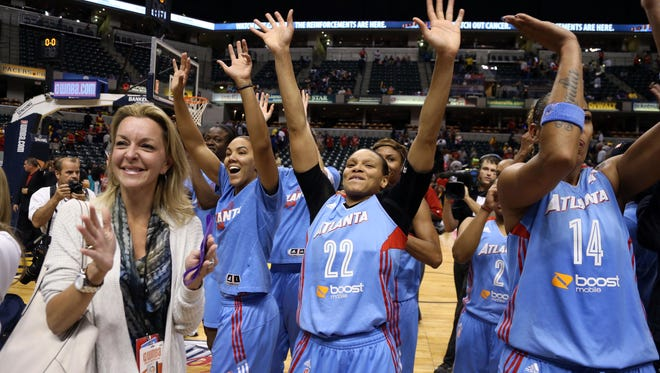 Atlanta Dream guard Armintie Herrington (22) and center Erika de Souza (14) celebrate after defeating the Indiana Fever at Bankers Life Fieldhouse.