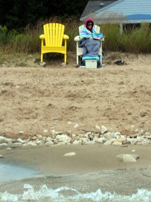 At noon on Sunday, Jennifer Moore of Hanover Park, Ill., was the lone beach-goer at chilly Beach Park in Egg Harbor at Alpine and Horseshoe Bay roads.