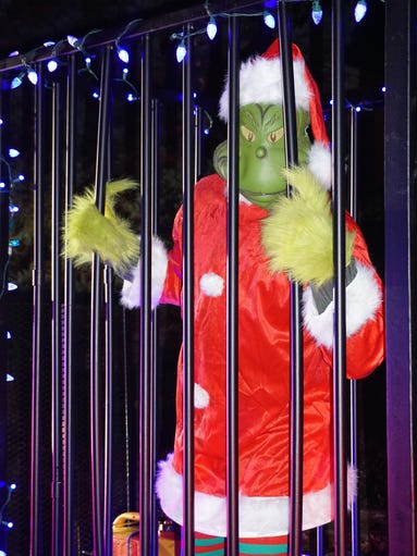 The Blue Santa of Spotswood led the Grinch, a suspect