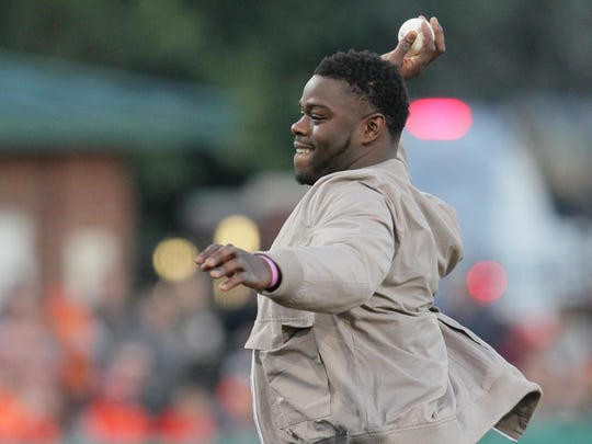Former Clemson football player Shaq Lawson throws the first pitch before the game with South Carolina on Friday at Doug Kingsmore Stadium in Clemson.
