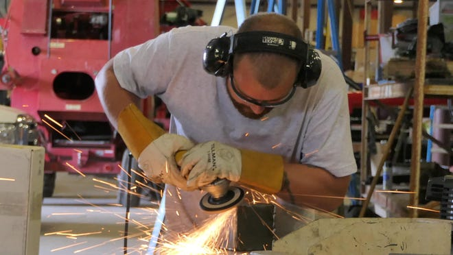 Logan Ahrens, of Hutchinson, works on the fabrication of a custom part at Kincaid Equipment Manufacturing in Haven.