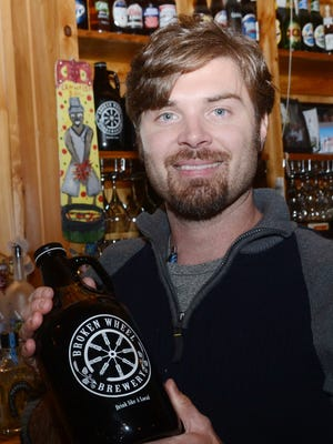 ANI Broken Wheel BreweryJohn Knoll (left) is the owner of Broken Wheel Brewery in Marksville. The brewery operates out of the Fresh Catch Bistreaux which is also owned by Knoll. Thursday, Feb. 19, 2015.-Melinda Martinez/mmartinez@thetowntalk.com The Town Talk Gannett