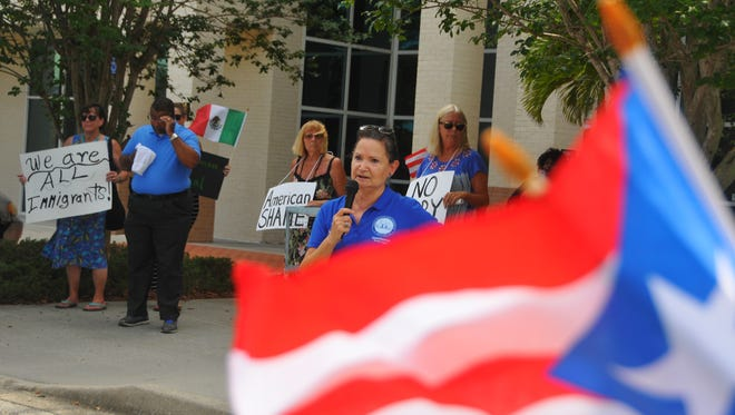 Approximately 70 people showed up at the  Government Complex in Viera outside Congressman Bill Posey's office to protest the recent immigration policies and the treatment of Puerto Rican evacuees from Hurrican Maria. Melbourne city councilwoman Teresa Lopez addresses the crowd.