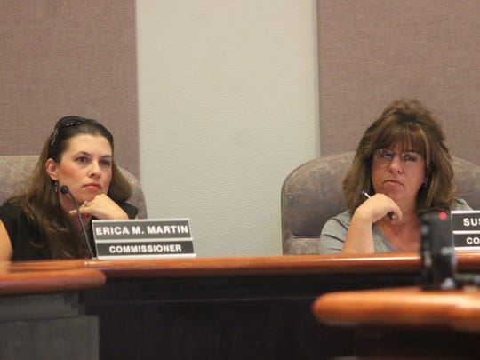 City Commissioners Erica Martin and Susan Payne listen as residents speak.