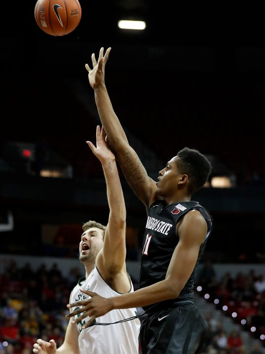 San Diego State's Malik Pope, right, shoots as Colorado State's Braden Koelliker defends during the first half of an NCAA college basketball game in the Mountain West Conference tournament semifinals Friday, March 10, 2017, in Las Vegas. (AP Photo/Isaac Brekken)