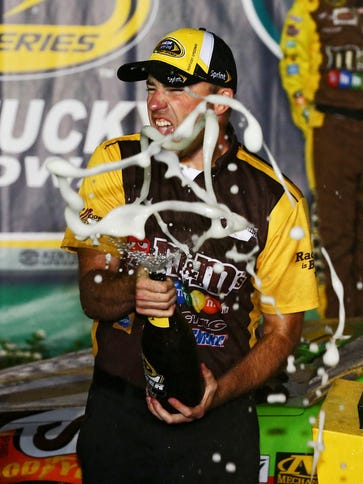 Crew chief Adam Stevens celebrates Kyle Busch's victory