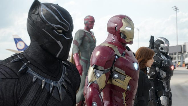 """""""Captain America: Civil War"""" pits Team Iron Man — Black Panther (Chadwick Boseman), Vision (Paul Bettany), Iron Man (Robert Downey Jr.), Black Widow (Scarlett Johansson) and War Machine (Don Cheadle) — takes on other Marvel heroes that are fighting the idea of coming under the thumb of the government."""