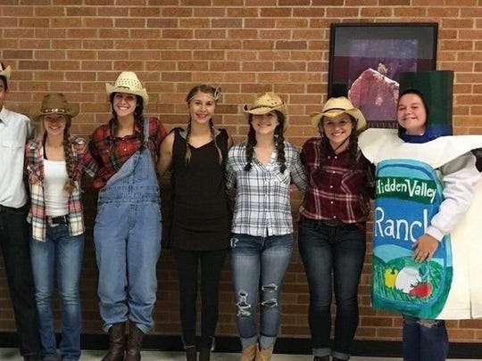 Carson Haase, far right, poses in her Ranch Day costume at Brandon Valley High School on Sept. 19, 2016.