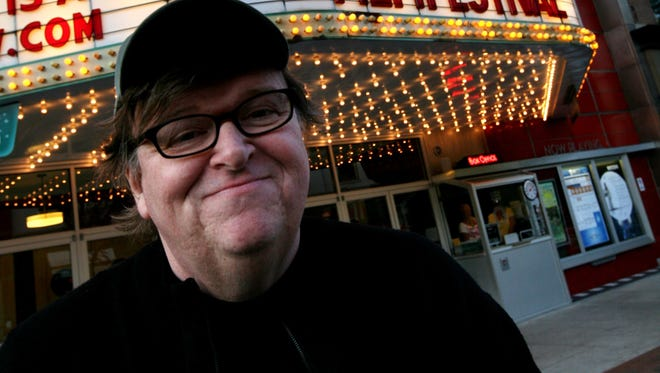 Oscar-winning documentary filmmaker Michael Moore no longer will serve on the Michigan Film Office Advisory Council after Republican Gov. Rick Snyder named a suburban-Detroit businessman to replace him.