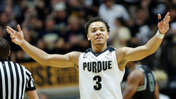 Carsen Edwards encourages the crowd after a dunk by