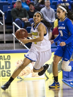 Delaware's Courtni Green drives to the basket in front of Hofstra's Krystal Luciano in the first half of Delaware's 54-47 win over Hofstra at the Carpenter Center this season.