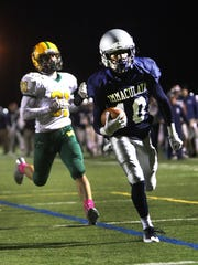 Montgomery high school vs Immaculata football at Somerville. Lata #10 Shahkyle Matthews runs in for a touch down in the first half Frtiday  October 28,  2016 ph