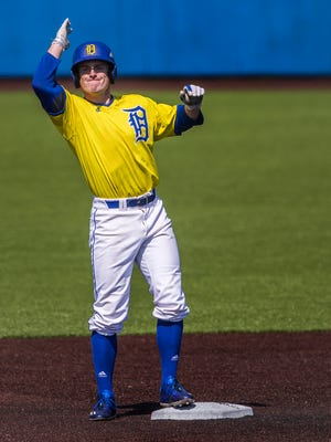 Delaware's Kevin Mohollen celebrates after hitting a double in the University of Delaware's 17-4 win over College of Charleston at Bob Hannah Stadium in Newark on Thursday afternoon.
