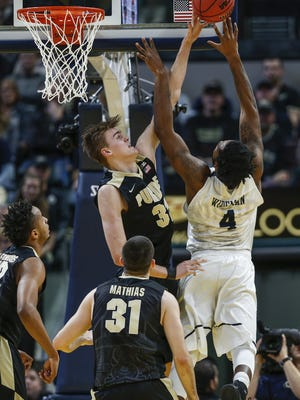 Purdue Boilermakers forward Matt Haarms (32) blocks a shot by Butler Bulldogs forward Tyler Wideman (4) during the Crossroads Classic at Bankers Life Fieldhouse in Indianapolis on Saturday, Dec. 16, 2017.