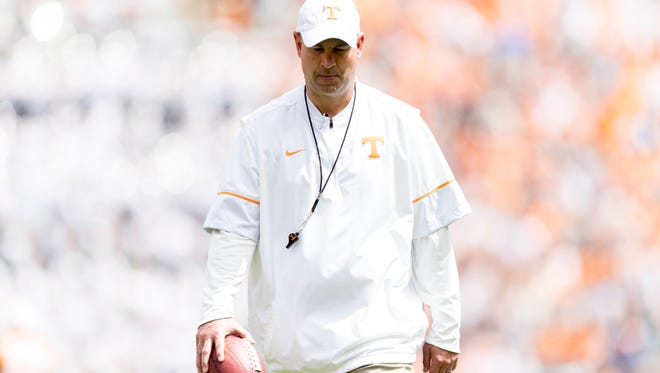 Tennessee Head Coach Jeremy Pruitt walks on the field during the Tennessee Volunteers Orange & White spring game at Neyland Stadium in Knoxville, Tennessee on Saturday, April 21, 2018.