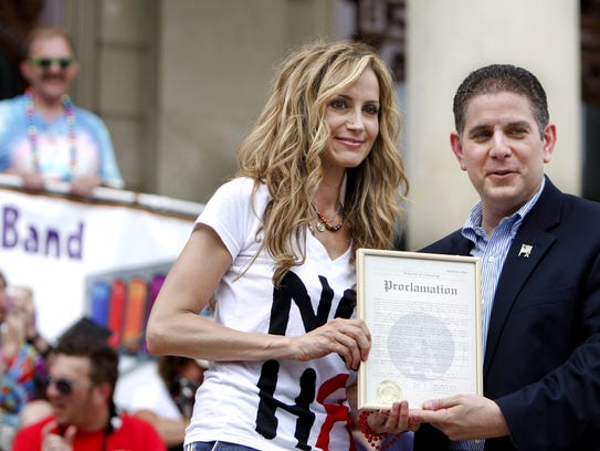 "Lansing Mayor Virg Bernero is known in the city a staunch advocate for gay, lesbian and transgender rights. He's pictured here in 2010 with Chely Wright, a country music singer who is openly gay. On July 12, 2010, Bernero proclaimed that date ""Chely Wright Day."""