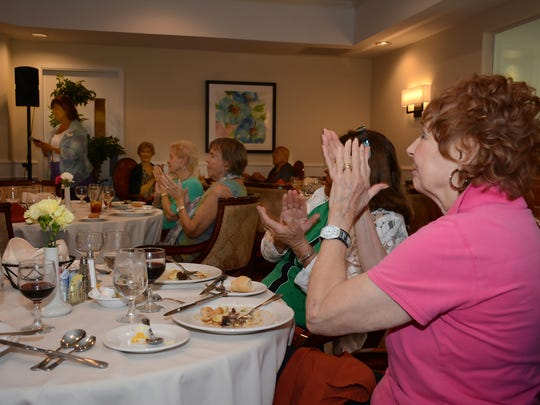 Guests applaud after sampling their meals. The Carlisle Naples held a cooking demonstration and luncheon on Thursday, Sept. 29, focusing on meals for older eaters and showcasing the culinary offerings of the North Naples retirement community.