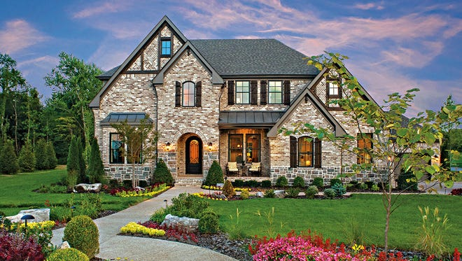 The Colinas II at Morgan Farms showcases luxury and character with its full brick and stone exterior.