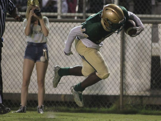 Lincoln receiver Derek Curry flies through the air