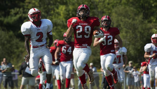 CVU's Braven Bose (29) runs for touchdown in the fourth quarter of a high school football game between the Rutland Raiders and the Champlain Valley Union Redhawks on Saturday afternoon.